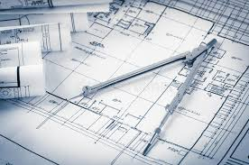 blue prints house rolls of architecture blueprints and house plans stock photo