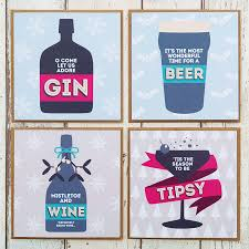 a set of four party drinks christmas cards by paper plane