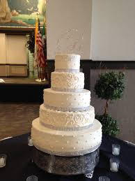5 tier wedding cake 5 tier buttercream wedding cake with dots scroll work and