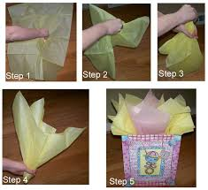 how to place tissue paper in a gift bag and make it look