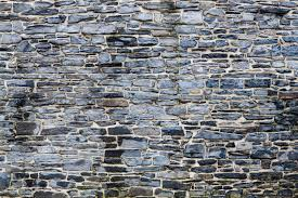 amount of material required to build a stone wall