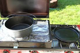 dutch oven cooking table using the c chef big gas grill as a dutch oven table