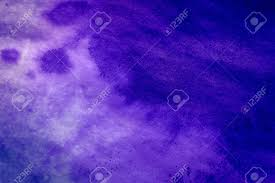 pattern of white clouds in streaks purple ink stain on a sheet of white paper macro abstract