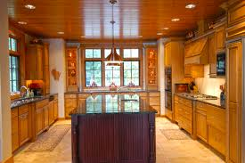 cedar ceiling in this kitchen kitchens by dickinson homes