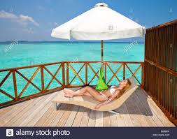 Aldi Outdoor Furniture Young Woman Tans On A Water Villa Terrace Maldiv Stock Photo