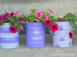 these are so cute recycle cans into sweet hanging planters i