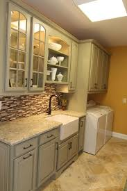 what color cabinets go with venetian gold granite venetian gold granite kitchen farmhouse with window