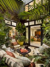 atrium design brings together indoor and outdoor living and allows