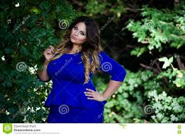 young beautiful plus size model in blue dress outdoors xxl woman