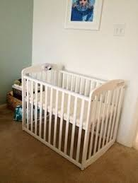 Rocking Mini Crib Small Cribs For Small Spaces Small Nurseries Mini Crib And Crib