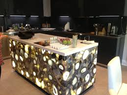 a kitchen island made of caesarstone concetto with led back light