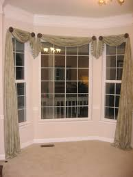 cool bay window design with beige floral curtain with large bay