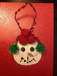 hand painted snowman face on a sand dollar jewelry i like