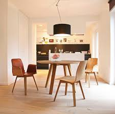 contemporary dining table wooden round commercial maverick