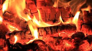 wood burning fireplace fireplace full of embers and flames with