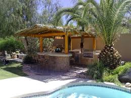 Amazing Outdoor Kitchens Bbq Island Tiki Bars And Island Design - Tiki backyard designs