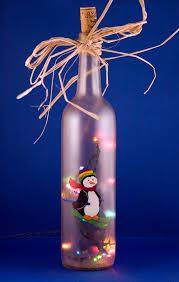 penguin skiing lighted wine bottle painted seasonal