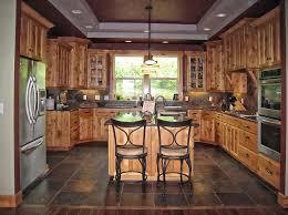 dark wood kitchen cabinets dark oak parquete flooring circle black dining table dark wood