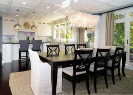 open floor plan kitchen dining room open plan soft white cabinets contrasting dark floors