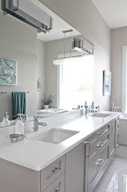 bathroom with floating gray vanity cambria quartz countertop
