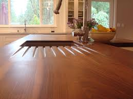 walnut countertop with grooves for water runoff kitchens