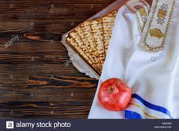 seder matzah white plate with matzah or matza and passover haggadah on a