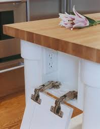 kitchen island electrical outlet hide your electrical outlets to streamline your kitchen design
