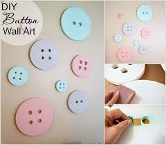 craft this cute button wall art for a baby nursery with painted