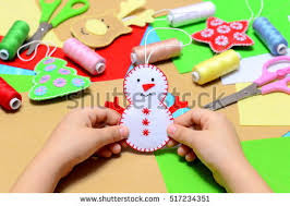 small child holding felt snowman stock photo 517234351