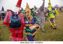 cajun mardi gras costumes revelers in traditional cajun mardi gras costumes in a farm