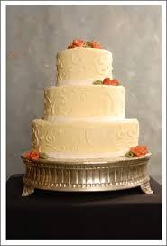 and elegant wedding cake with orange flowers