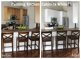 painting kitchen cabinets from wood to white kitchen makeover phase one painting our cabinets white