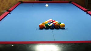 Felt Pool Table by Game Of Pool With Blue Felt Pool Table Shot Of Break Stock