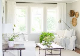 White Slipcover Sofa by Woven Wood Shades In Our Living Room A Burst Of Beautiful