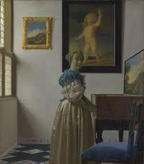 vermeer pearl necklace johannes vermeer woman standing at a virginal 1672