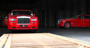 rolls royce gold and red rolls royce delivers 30 red phantoms to macau hotel