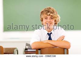 Picture Of Student Sitting At Desk Cute Middle Student Sitting Against Lockers Stock