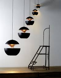 Wohnzimmerlampe 50er Jahre Pendelleuchte Im Sixties Design Here Comes The Sun Schwarz Von Dcw