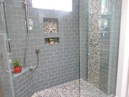 bathroom tile ideas for shower walls grey glass subway tile shower featuring bali pebble