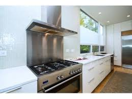 brilliant stunning stainless steel backsplash behind stove image