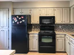 can cabinets be same color as walls outdated oak cabinets get a fresh look painted by payne