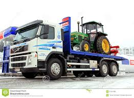 2014 volvo semi truck price volvo fm 370 truck and john deere 1640 tractor as cargo editorial