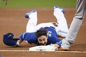 toronto blue jays darwin barney struggles sliding into third base