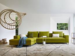 green living room furniture green area rug colorful floral area