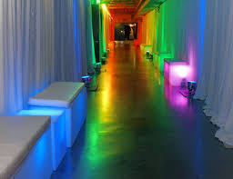white pipe and drape colored lights and glow furniture
