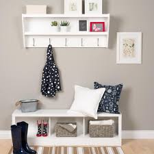 furniture entry way with white wooden storage bench plus coat