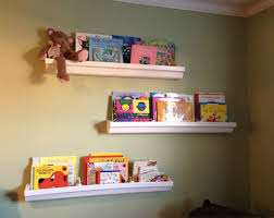 Vinyl Rain Gutter Bookshelves - diy make nursery bookshelves out of rain gutters disney baby