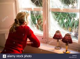 looking out of window with decorations stock photo