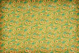 green and yellow vintage floral wallpaper with a dense repeat