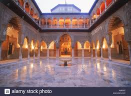 almohad gothic style rooms and courtyards of alcazar palace in